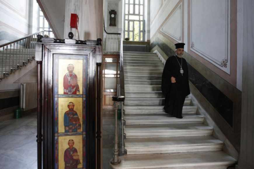 "Metropolitan Apostolos Daniilidis, an Orthodox bishop at the monastery attached to the Halki school, is seen at the ""Tracing Istanbul"", an exhibition of works by Greek artists, at the Greek Orthodox seminary in Heybeliada island near Istanbul September 4, 2010. An Istanbul seminary closed in 1971 is hosting its first public event in 40 years, raising hopes it may shortly be reopened by Turkey and once again educate priests for the Greek Orthodox community. The European Union and the United States have pressed EU membership hopeful Turkey to reopen the historic school, which occupies a beautiful and commanding site at the top of the island of Heybeliada, or Halki in Greek. Picture taken September 4, 2010. To match Reuters Life! TURKEY-RELIGION/SCHOOL REUTERS/Osman Orsal (TURKEY - Tags: RELIGION SOCIETY EDUCATION) - RTR2I2DW"